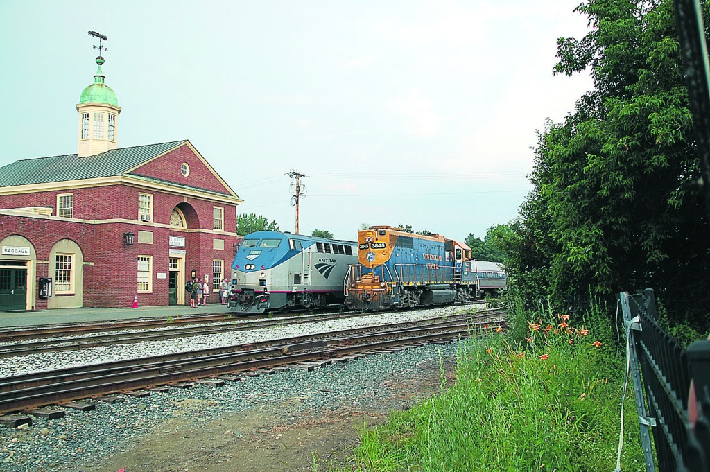 Amtrak's Vermonter stops in White River Junction, passing a New England Central Railroad freight train. State involvement has upgraded the track used by the Vermonter, paid for its operation, and purchased the White River Junction station and the freight tracks behind it that lead up the Connecticut River valley.