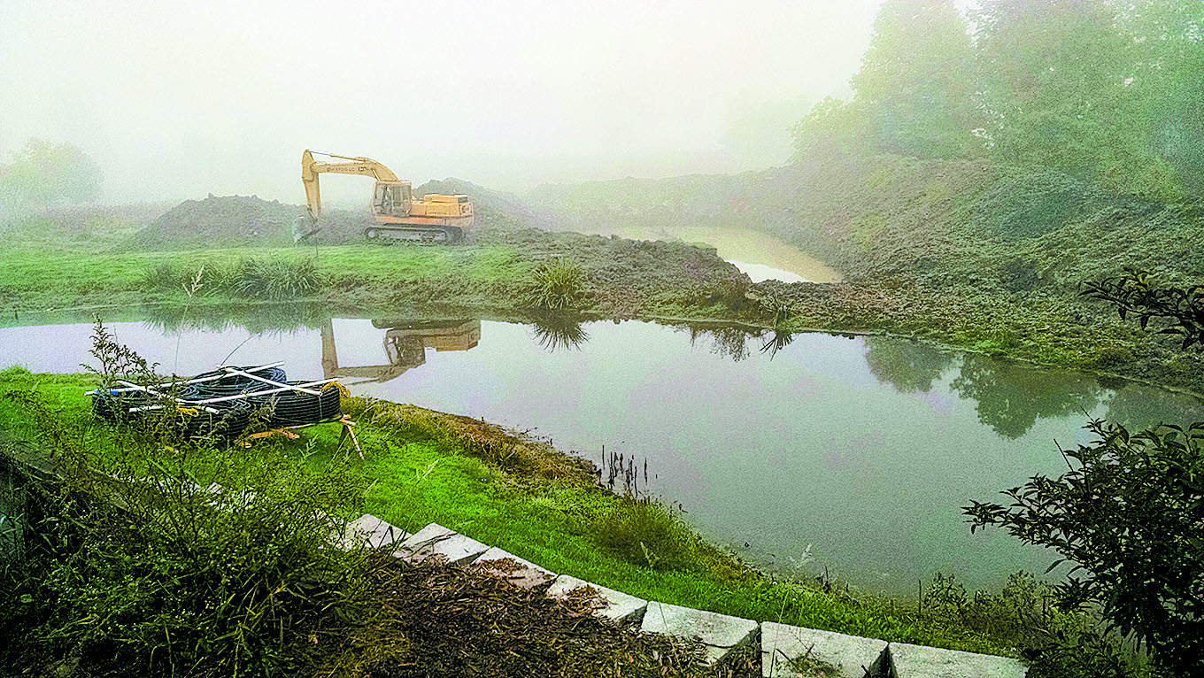 Pond expansion for geothermal loop operation. Photo courtesy of Stuart Anderson.