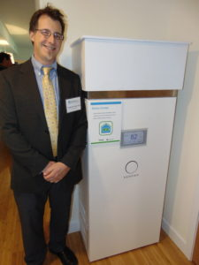Todd Olinsky-Paul, Project Director at Clean Energy Group, stands next to a sonnenBatterie unit. Photo courtesy of Clean Energy Group.