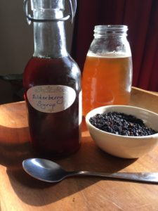Elderberry syrup made with honey and dried elderberries.