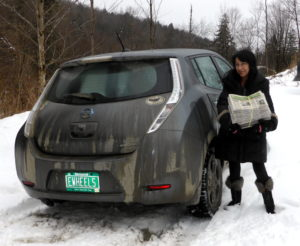 "Barbara delivers Green Energy Times, what they consider the ""real news"" paper, with their all-electric Nissan Leaf."