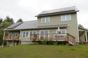 A BrightBuilt Home in Meriden, NH. This zero energy home was built by RH Irving. This south-facing side features Logic windows and doors and a solar array installed by Norwich Solar Technologies;