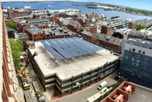 The 193 kW solar canopy at Fore Street Garage in downtown Portland, Maine is the first-of-its-kind in Maine, though solar canopies are common in other parts of the United States. The project is the result of a collaboration between ReVision Energy, East Brown Cow, and Quest Renewables. The clean electricity generated by the system will power the nearby Hyatt Place Hotel, and offset more than 20% of their electrical loads.. Photo: John Capron.