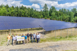 Net Zero Montpelier team members gather at the Log Rd 500-kW array in Montpelier, that was completed in 2017. Photo: John Snell